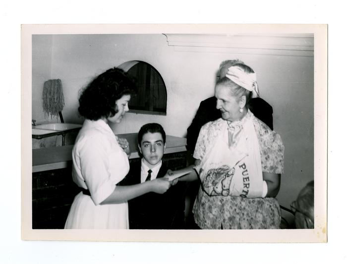 San Juan mayor Felisa Rincón de Gautier (1897-1994) meets Puerto Rican young adults while she visits Philadelphia