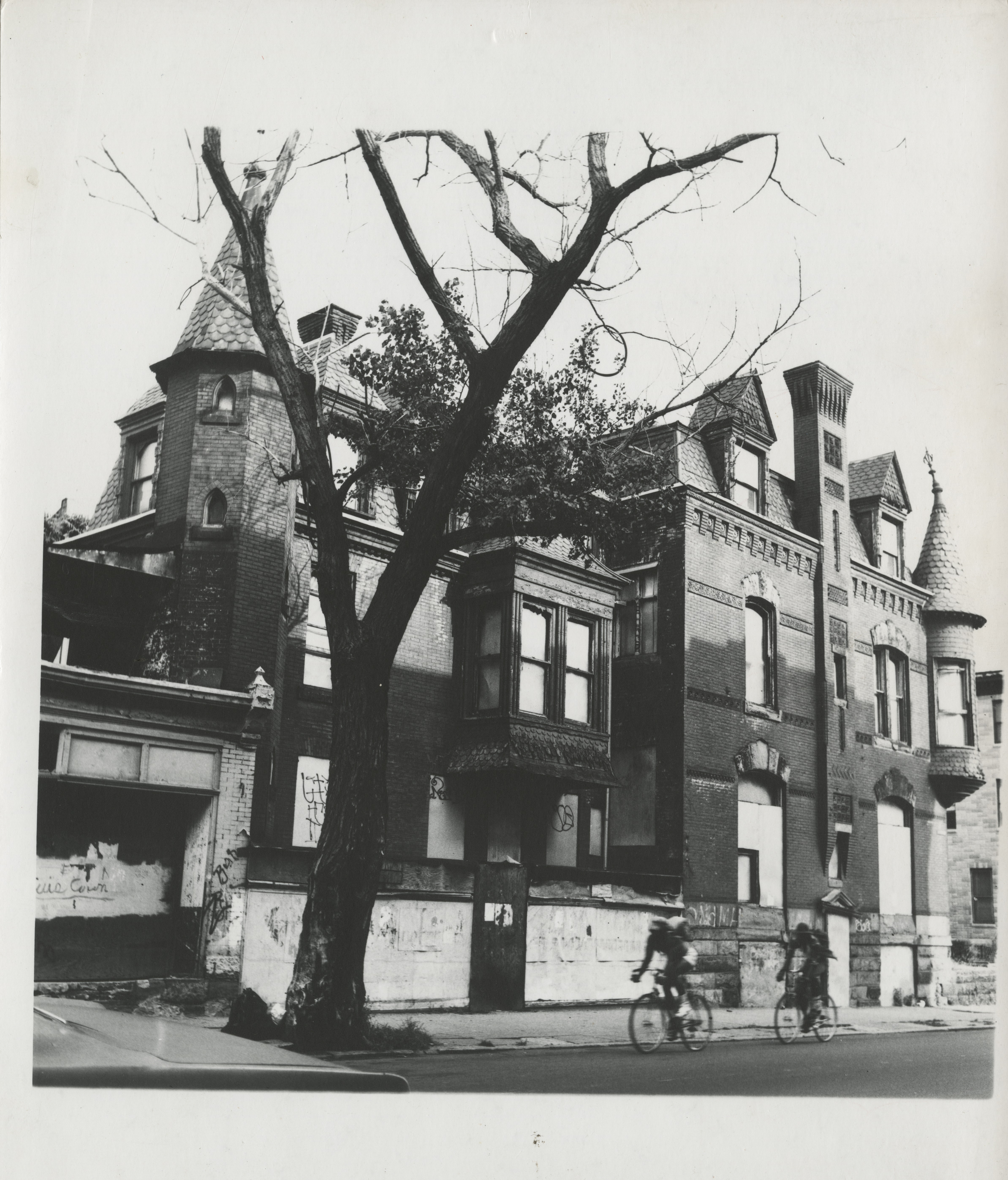A West Philadelphia home with boarded windows and graffitied walls