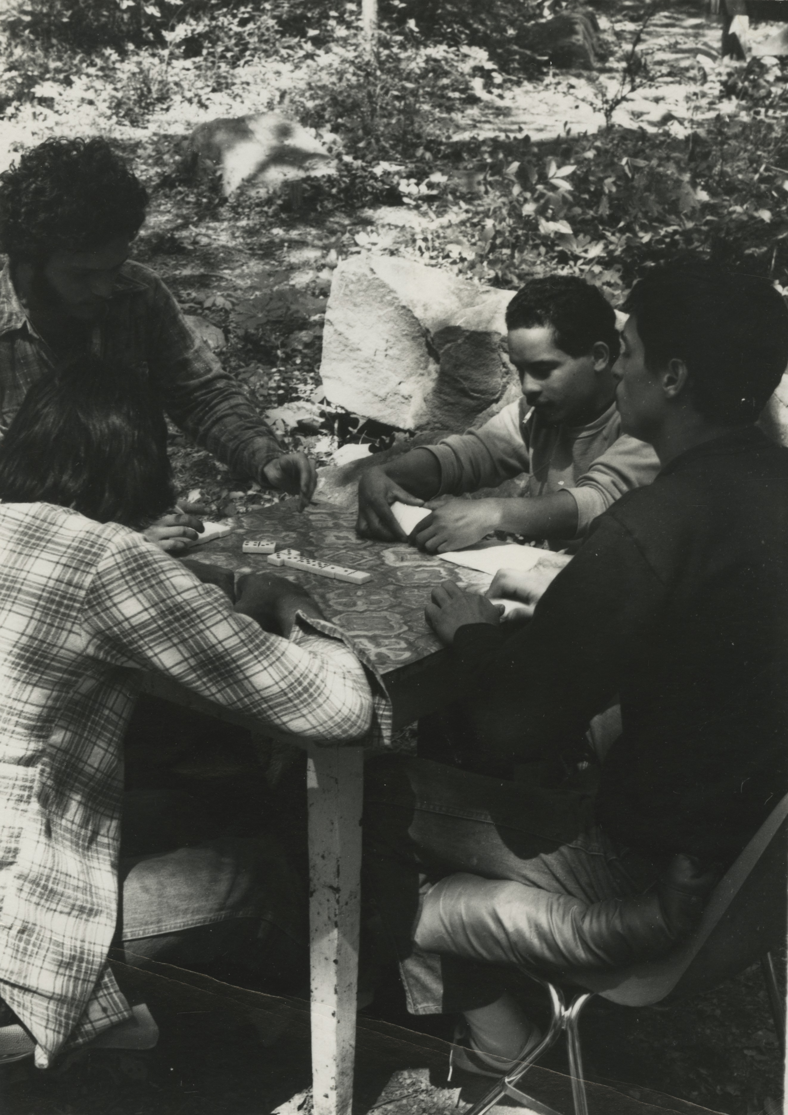 Friends gather to play Dominoes